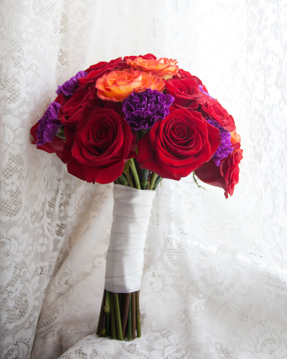 bridal flower bouquet red orange purple white ribbon.jpg