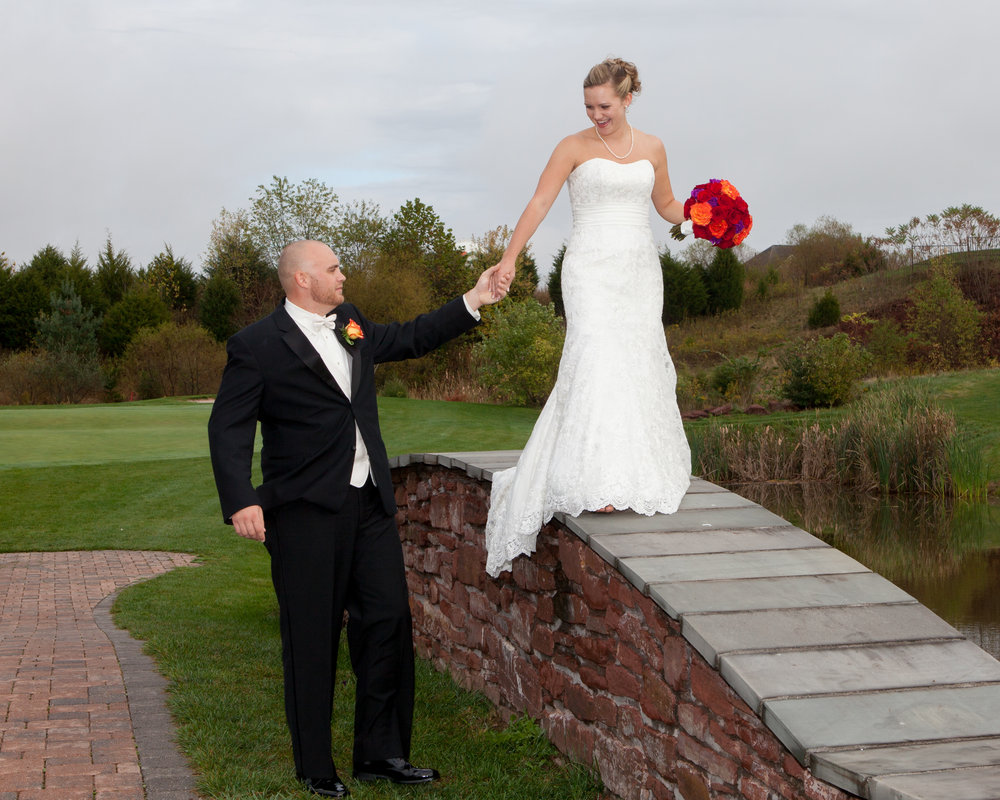 bride and groom photo on bridge at the links at gettysburg pennsylvania.jpg