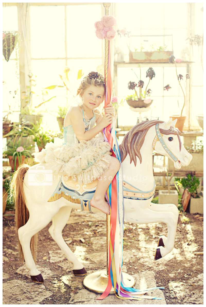 Childrens Portrait on Carousel Horse by The Suitcase Studio