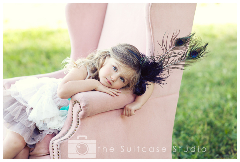 Stylized Childrens Portrait in Pink Chair in Field by The Suitcase Studio