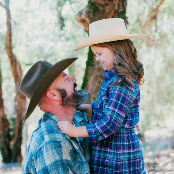 father and daughter sharing a moment in a documentary photo session with the suitcase studio
