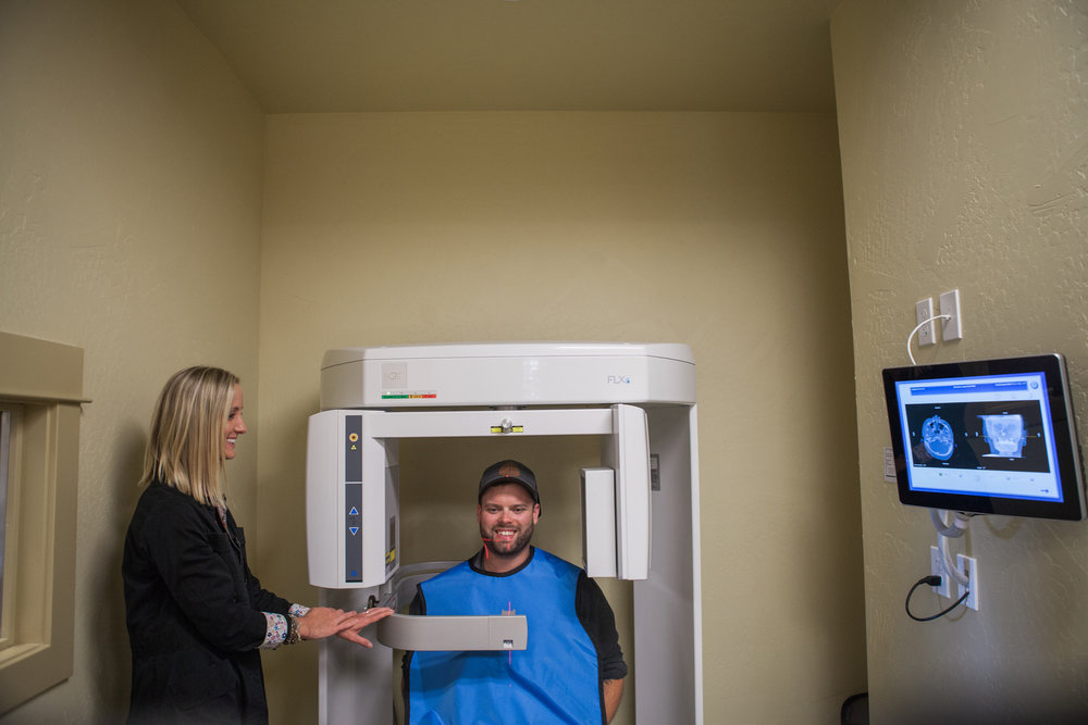 The Suitcase Studio - business photos showing off technology offered by dentist Kelley Mingus