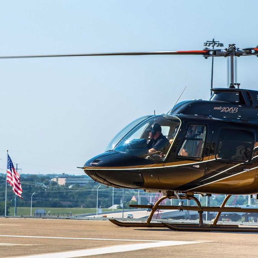 Waiting_in_the__helicopter_for_a_passenger_pick_up.__flyphs.jpg