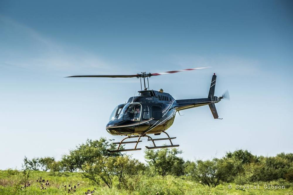 It_s_a_beautiful_day_in_the_fields_of_North_Texas_for_some__helicopter_work.__flyphs.jpg