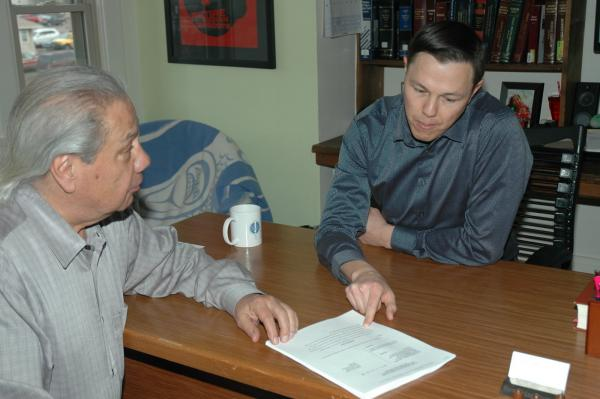 From left, Native American Rights Fund attorneys John Echohawk (Pawnee) and Matthew Campbell (Native Village of Gambell) look over a voting-rights complaint just filed in U.S. District Court in North Dakota. Courtesy NARF.