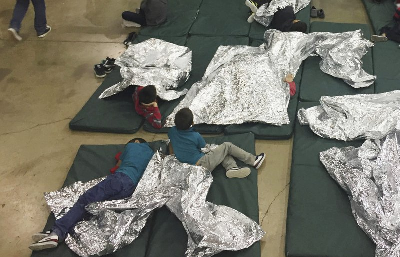 The children are given foil-like blankets for warmth