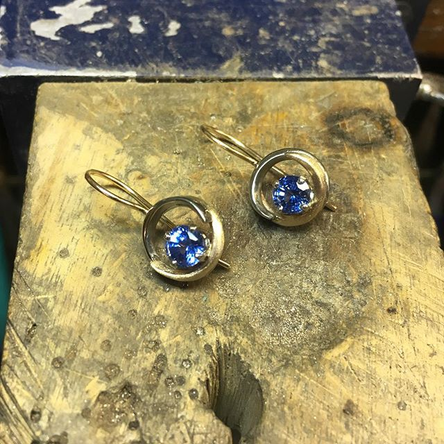 A pair of wedding bands gets a new life, transformed into custom 14k white and yellow gold earrings set with periwinkle sapphires. #laurakieferdesigns #oldisnewagain
