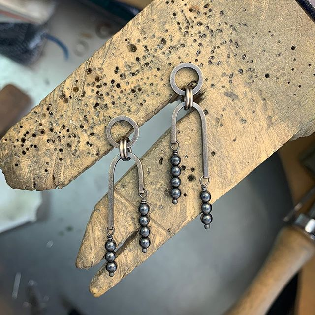 Sterling and hematite earrings inspired by a style I saw in HBO's series Rome (seriously) that came out looking pretty Art Deco. #sterling #hematite #beads #artdeco #denvermade by #laurakieferdesigns