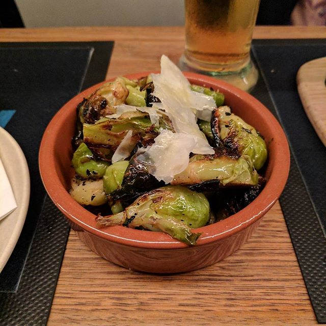 Tasty fresh from the pizza oven; roasted Brussels Sprouts. #littleballsoflove