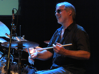 Great podcast interview with Paul Wertico and chock full of info. Paul has a revolutionary new book out called Turn the Beat Around and he discusses the concept, along with his 6th CD with Wertico, Cain and Gray. Paul is one of those guys who has so much knowledge to impart...which I guess is why he's an Associate Professor of Jazz Studies at Roosevelt University in Chicago...take a listen.