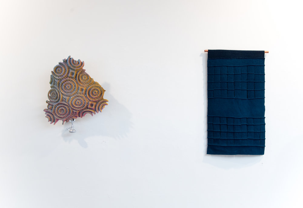 "Left:  Topper   Cement, acrylic paint, spray paint, wire mesh, glass carafe insert, door knob, bolts, wall latch. 23""x18""x7"" 2017  Right: Textiles by  Megan Mesloh   Photo Credit:  Jason Horvath"