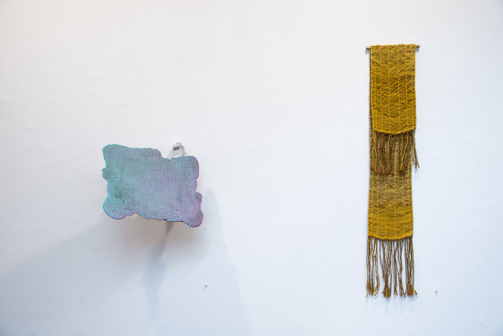 "Left:  Spray   Cement, acrylic paint, spray paint, wire mesh, sprayer and dip tube, towel hook. 13""x14""x12"" 2017  Right: Textiles by  Megan Mesloh   Photo Credit:  Jason Horvath"
