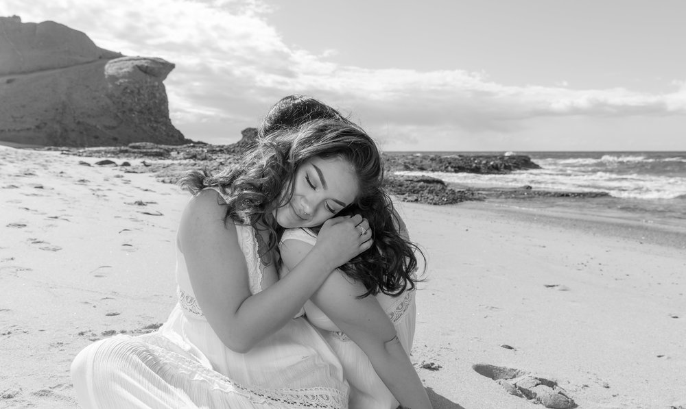 Two Gals Hugging on the Beach for Engagement Pictures.jpg