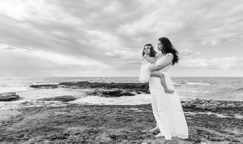 Mother holding daughter on the shores of Laguna Beach.jpg