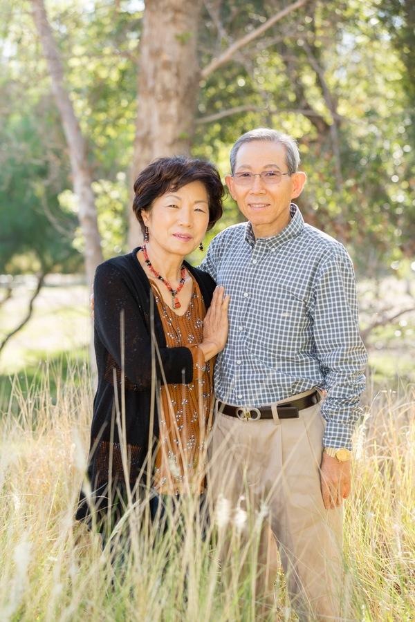 Grandparents Family Portrait standing in tall grass at Yorba Regional Park.jpg