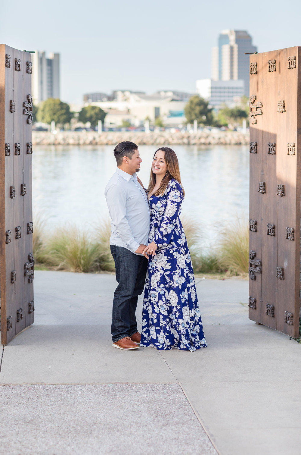 Wooden doors frame engagement couple in Long Beach Photo Session.jpg