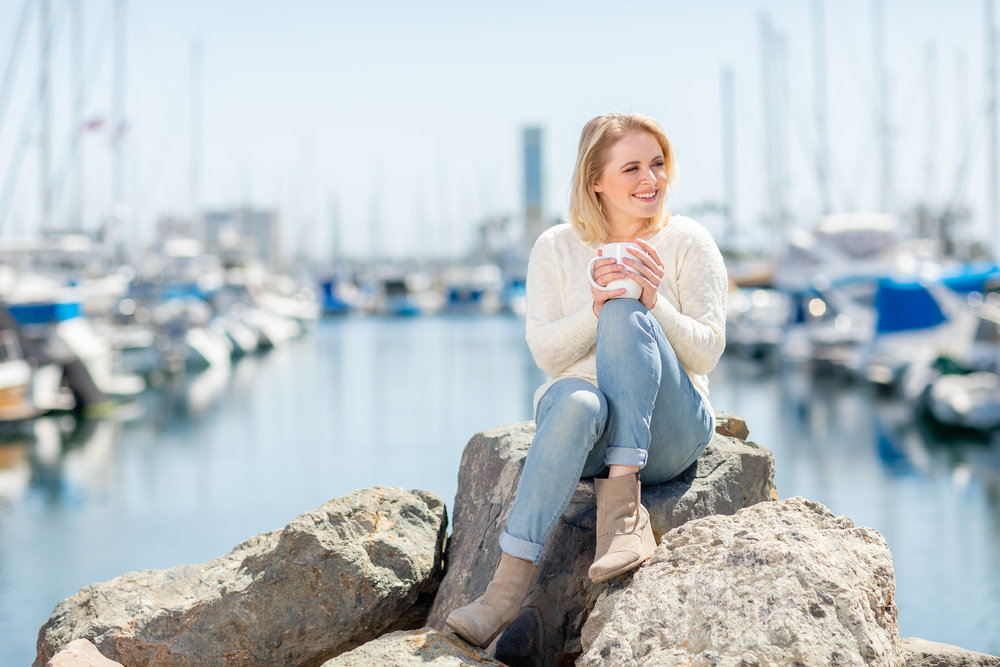 Beautiful blonde sipping coffee along the harbor.jpg