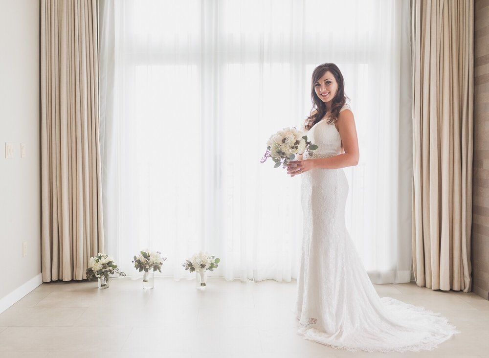 Bridal Portraits by floor to ceiling window.jpg