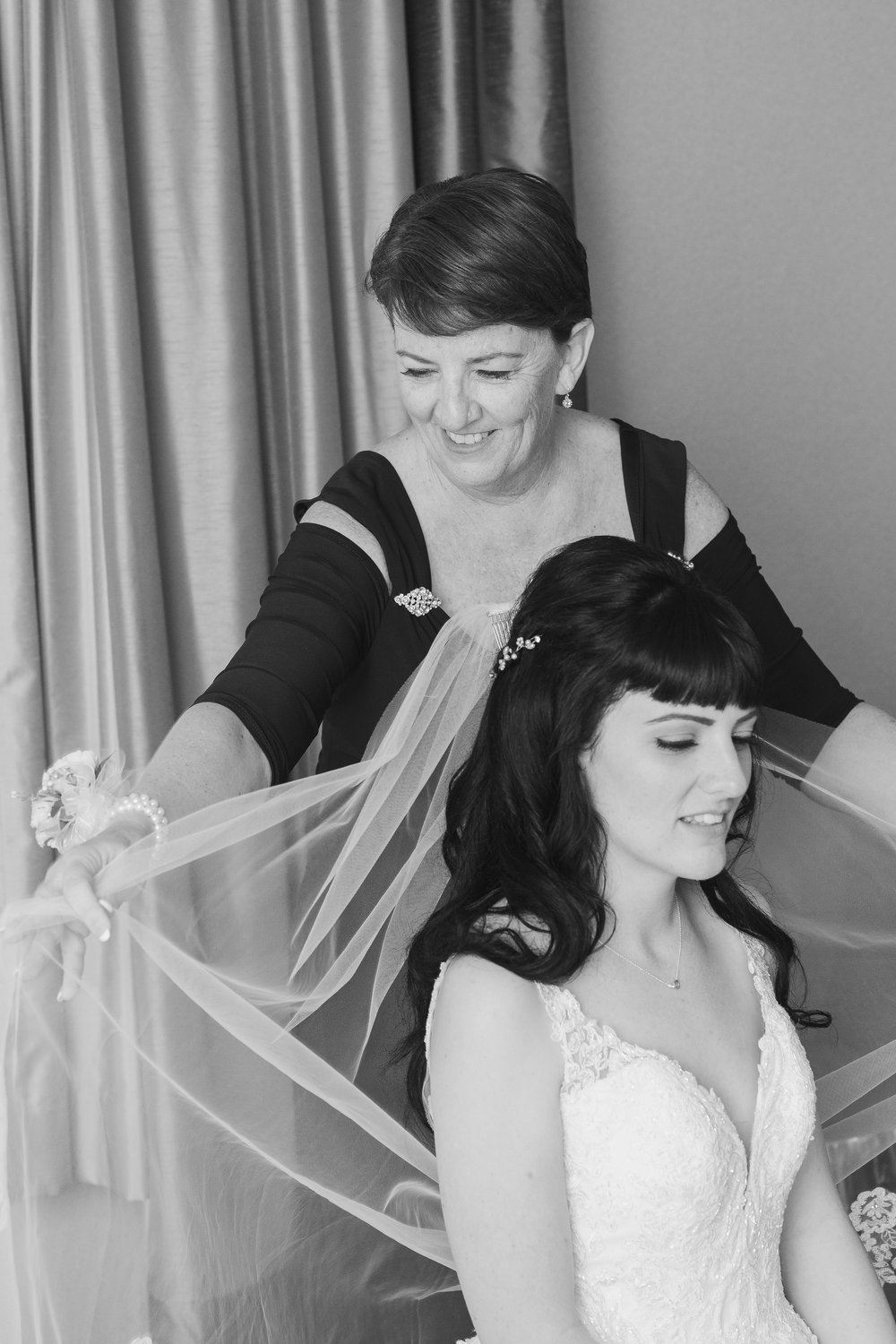 Photo of mother fixing veil of bride during getting ready.jpg