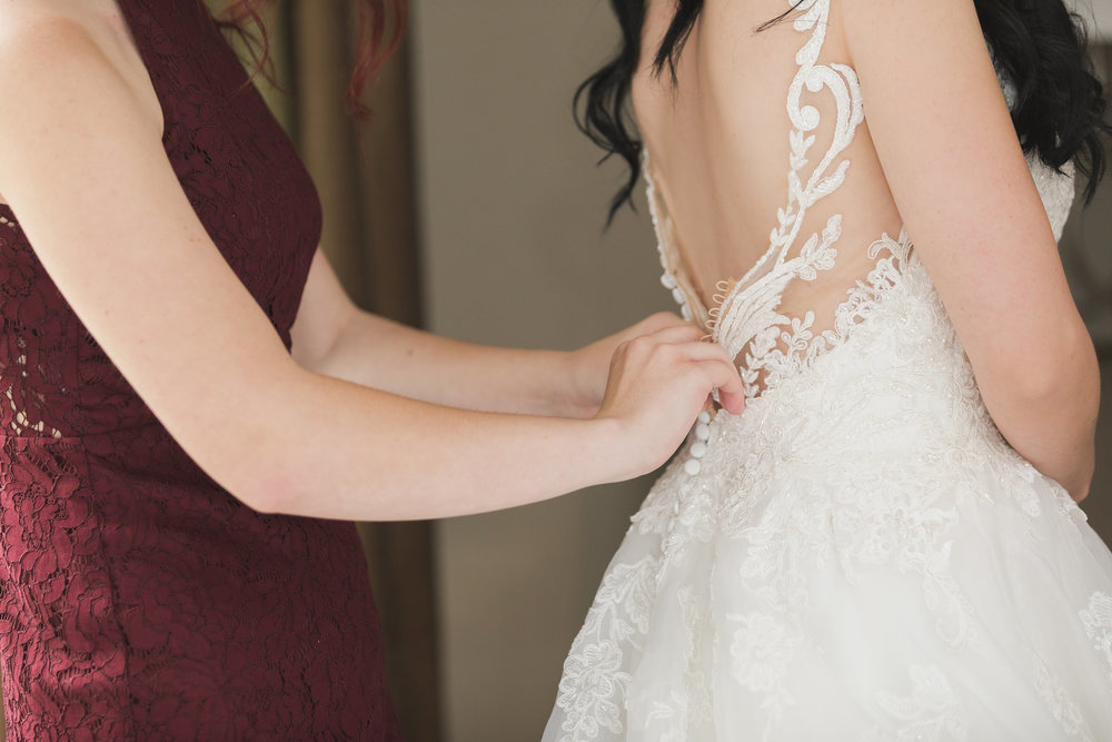 Photo of Maid of Honor Assisting Bride.jpg
