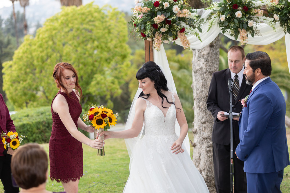 Photo of Bride passing bouquet to Maid of Honor.jpg