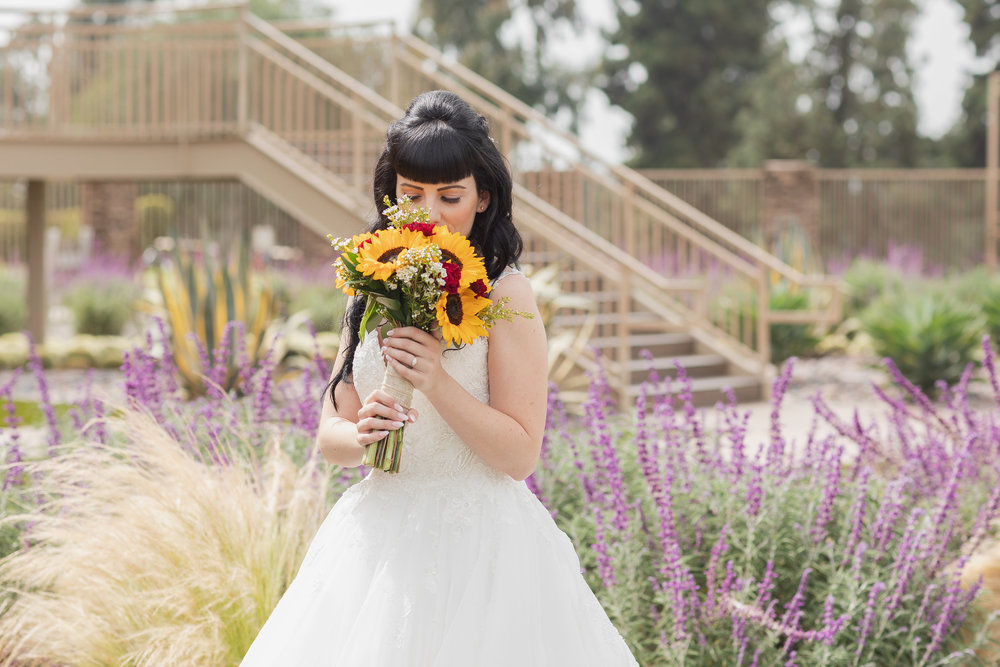 Photo of Bride smelling her sunflower wedding bouquet.jpg