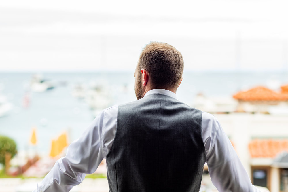 Photo of groom looking out of Avalon balcony.jpg
