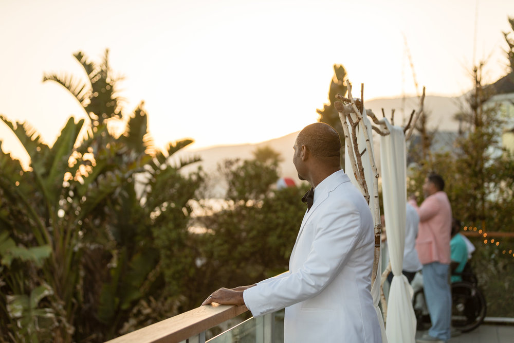 Photo of Groom in a White Tuxedo at Sunset.jpg