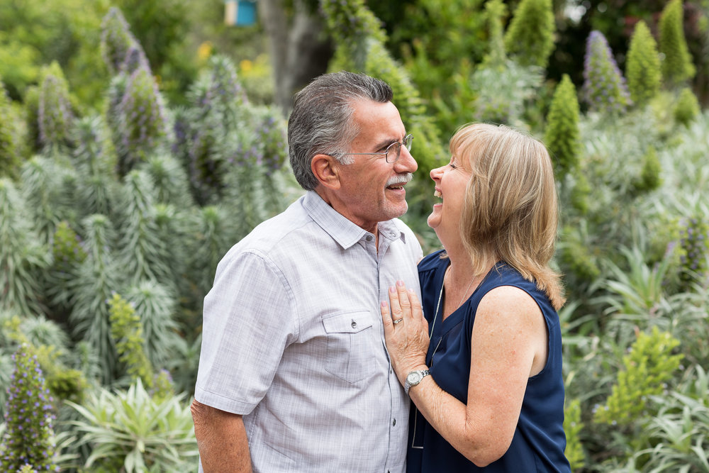 Happy Husband and Wife picture in Huntington Beach garden on overcast morning.jpg