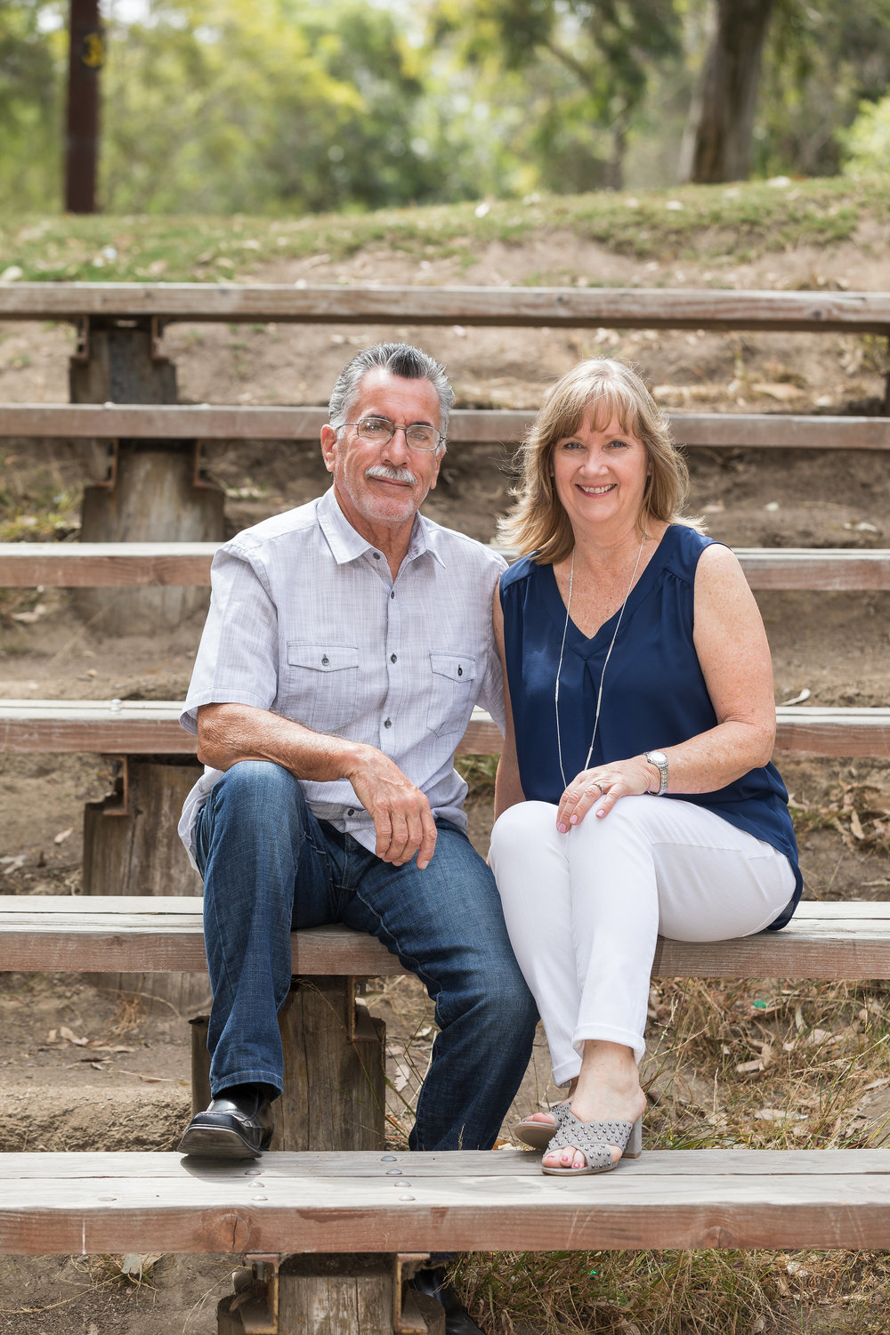 Photo of husband and wife sitting on the steps in HB park.jpg