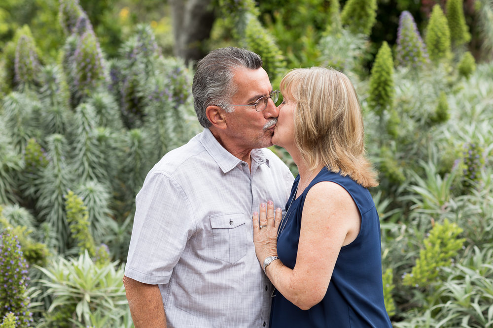 Photo of husband and wife smooching in the HB garden.jpg
