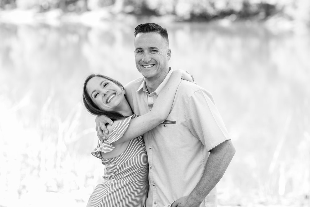 Photo of adult fraternal twins smiling for the camera in black and white.jpg