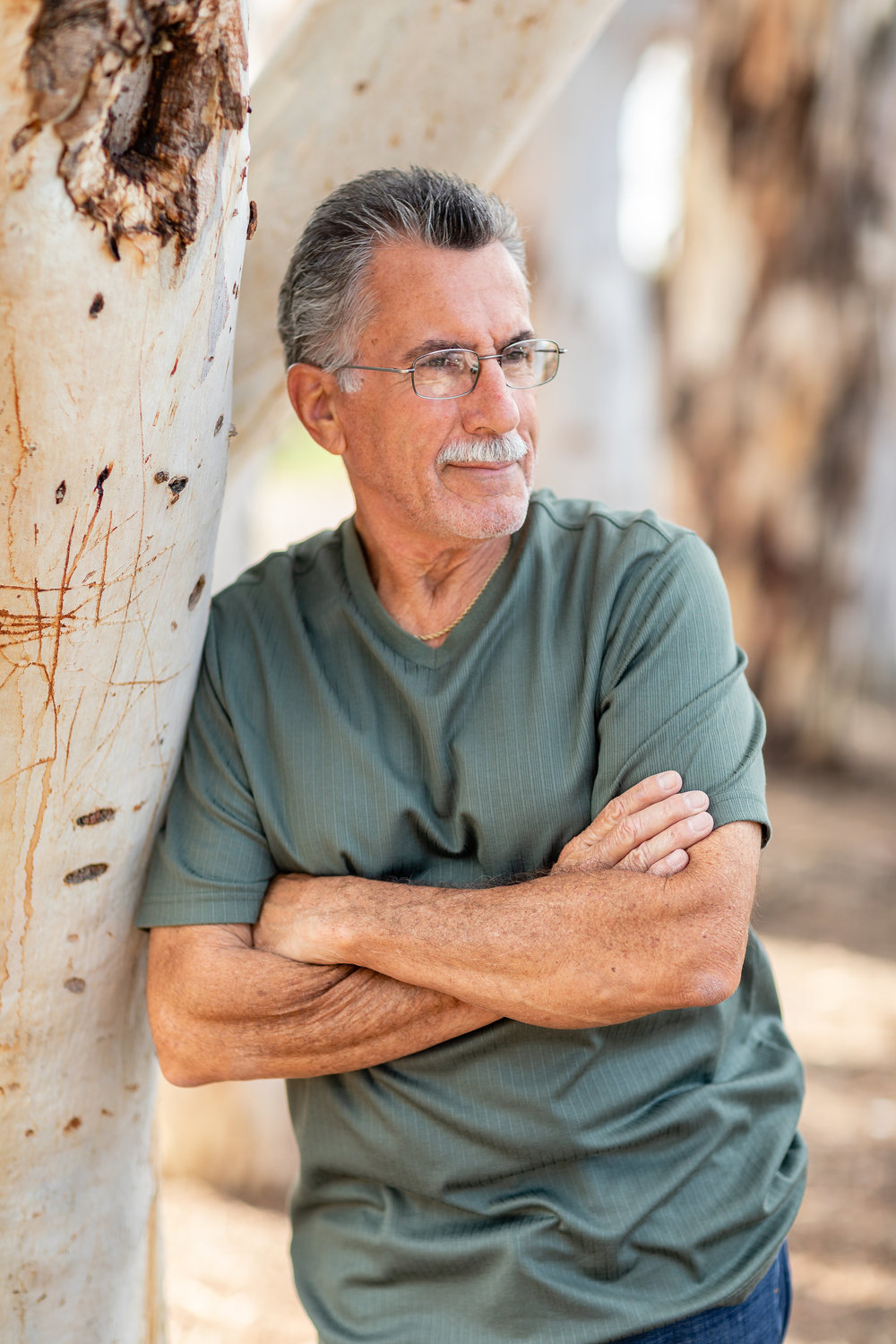 Lifestyle portrait of father leaning against an HB park tree - male posing ideas.jpg