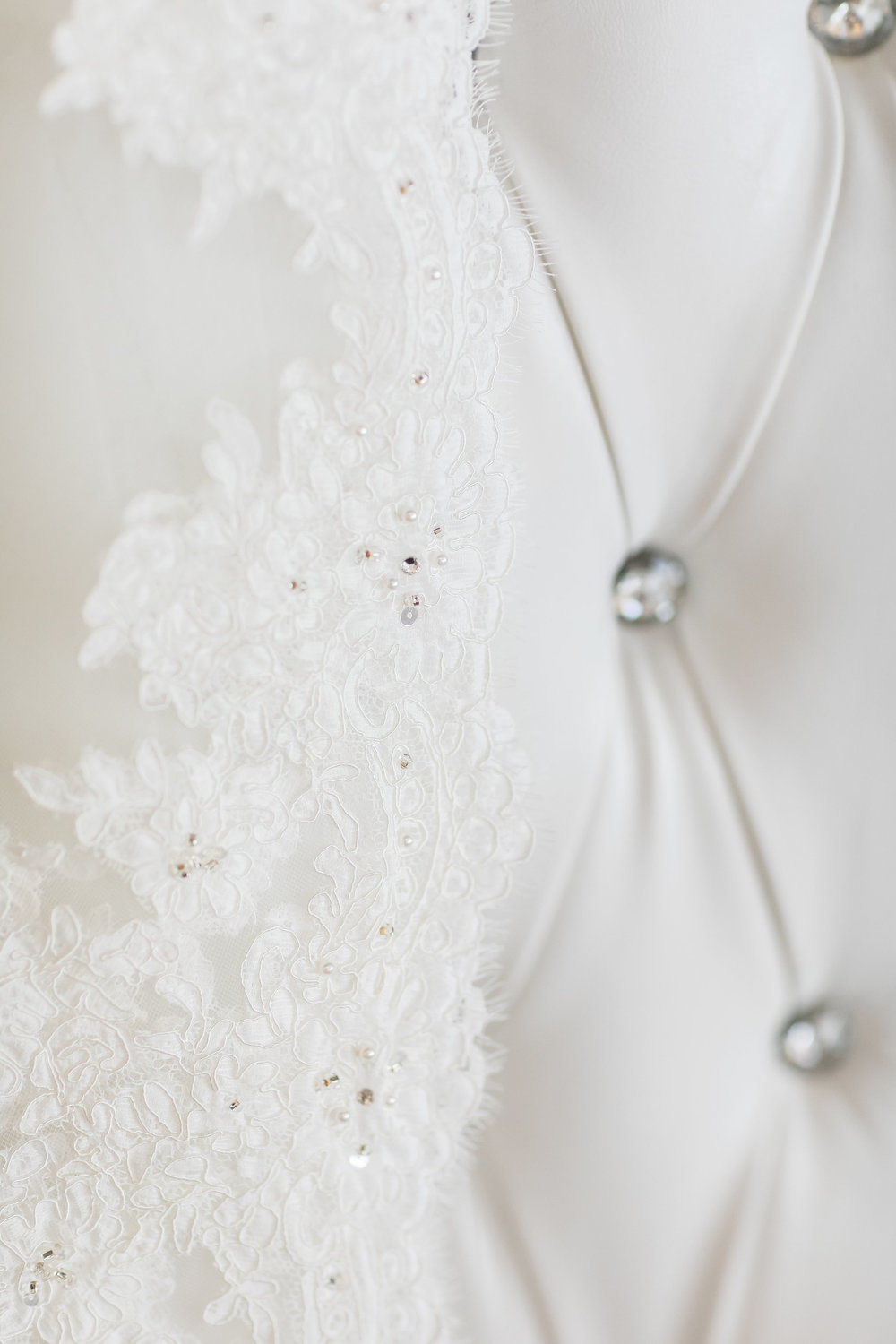 Photo of Luxury Wedding Veil on a King and Queen White Chair.jpg