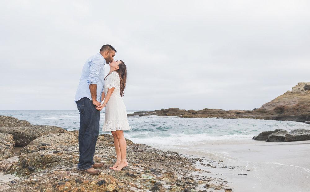 Newly Engaged Couple Share a Kiss on Laguna Beach.jpg