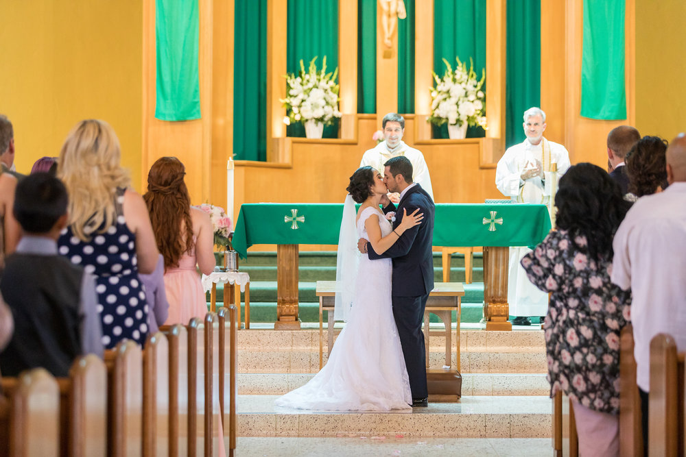 ! First Kiss as Husband and Wife in Catholic Church.jpg