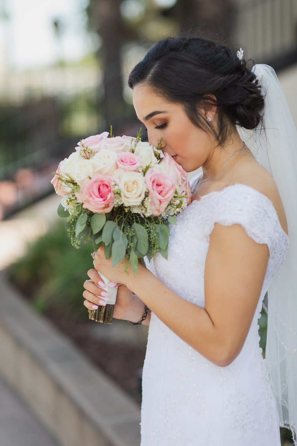 ! Profile Bridal Portrait smelling flowers.jpg