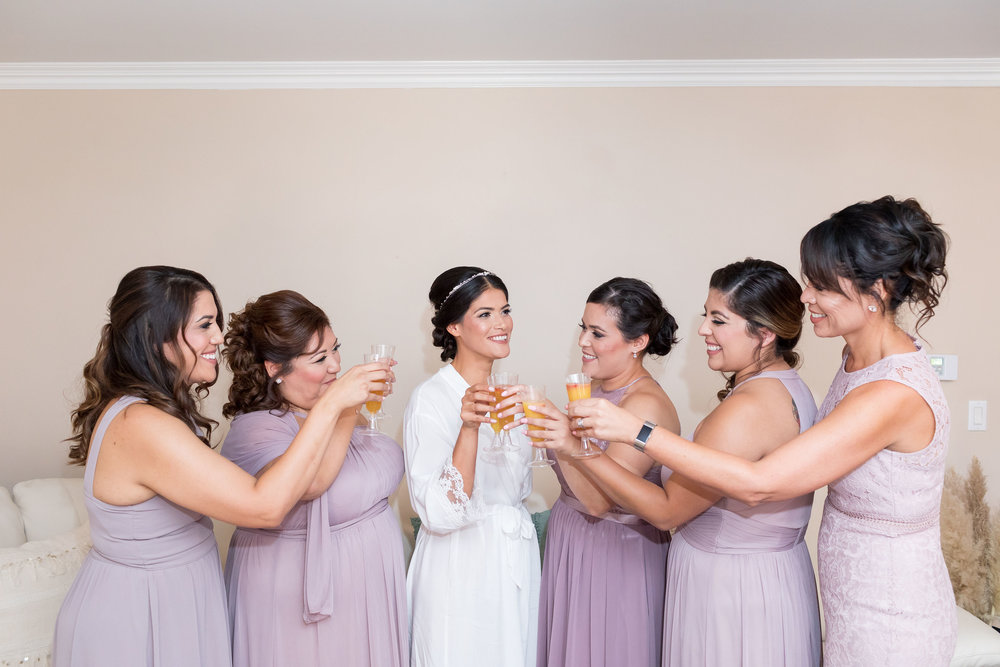 ! Bride and Bridesmaids Getting Ready with Momosas.jpg
