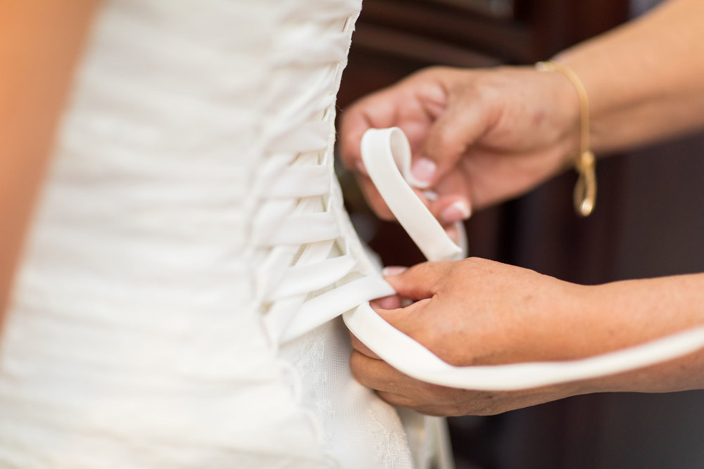 ! Lacing up Wedding Dress During Getting Ready Photos.jpg