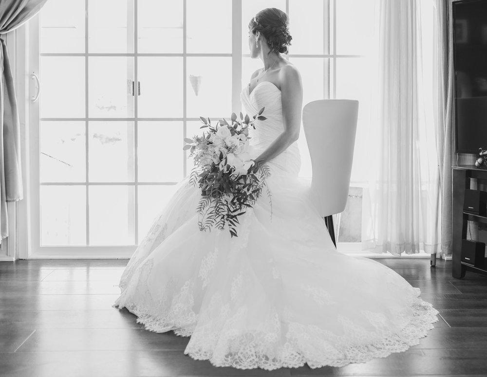 ! Bride Waiting for her Wedding sitting in a white chair with her bouquet.jpg