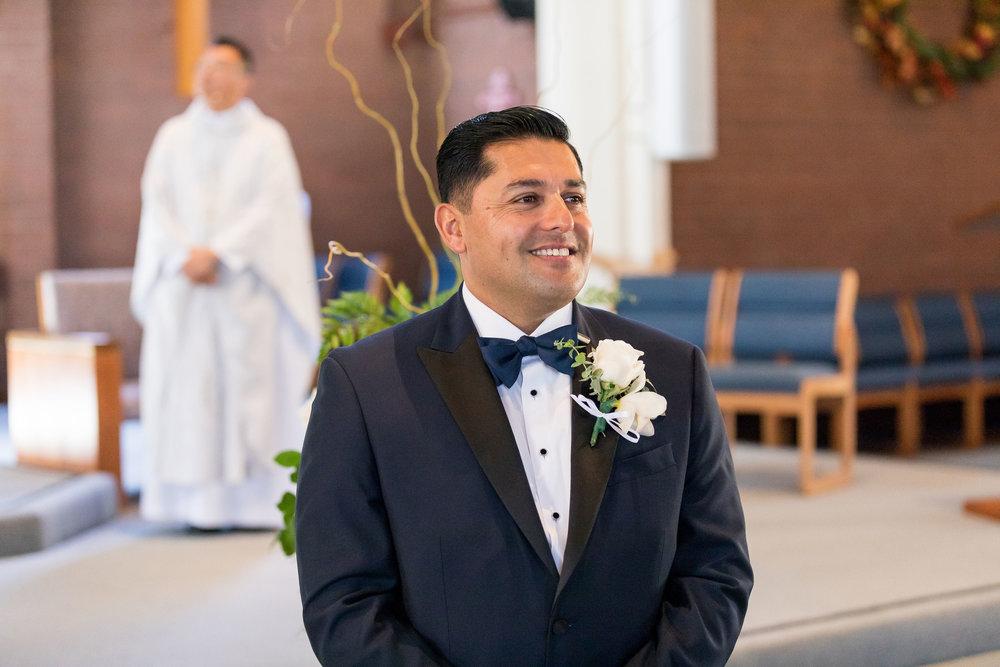! Happy Groom waiting for his bride n Catholic church.jpg
