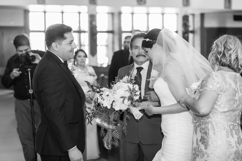 ! Bride meeting her Groom at the church alter.jpg