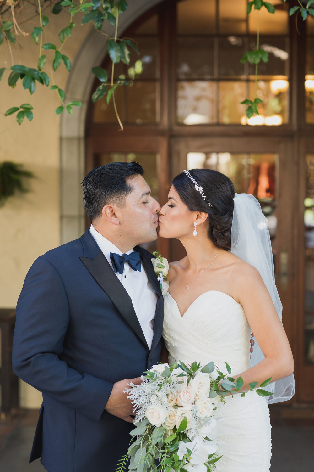 ! Bride and Groom share a kiss at Green Parrot Villa.jpg
