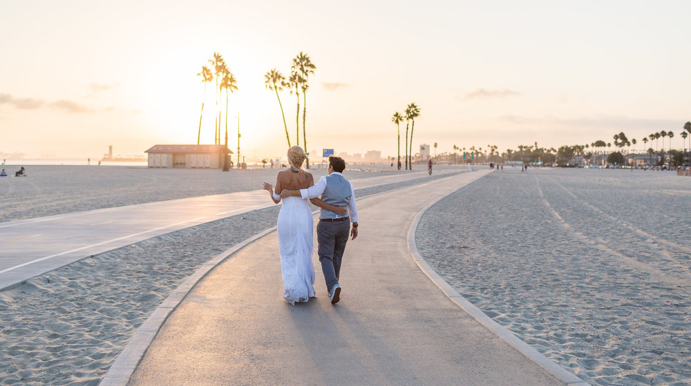 Newlyweds walking off into the sunset.jpg