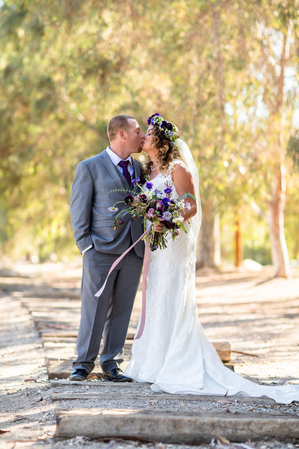 Bride and Groom Portraits on the train tracks Blomgren Ranch.jpg