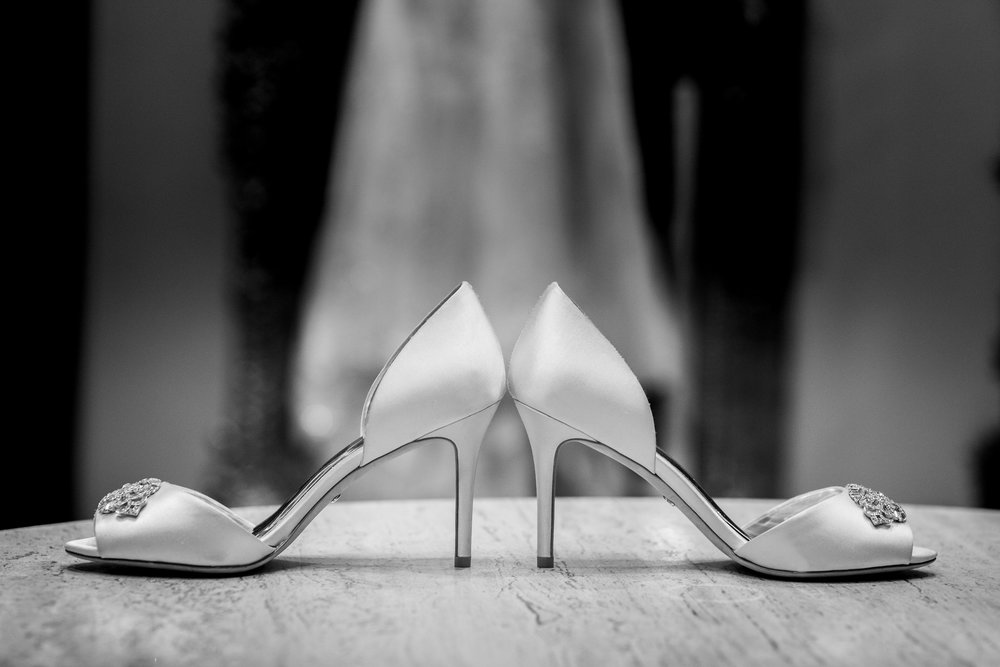 BW Photo of Getting Ready Wedding Shoes.jpg
