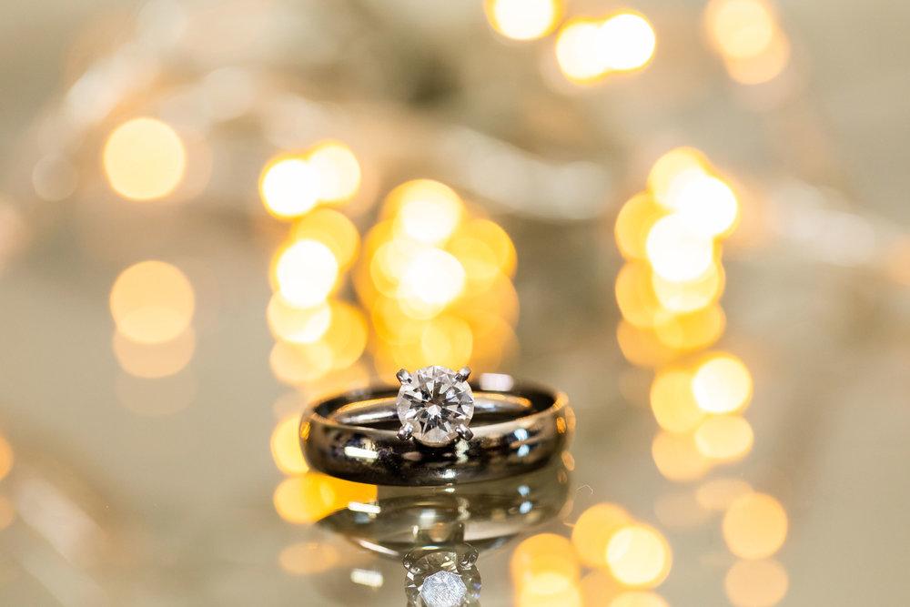 ! Wedding Ring Shot with Lights behind.jpg