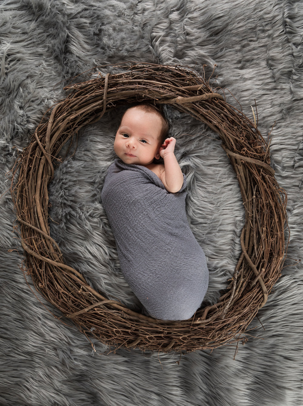 ! 1 month old baby boy home photo session gray rug and brown wreath.jpg