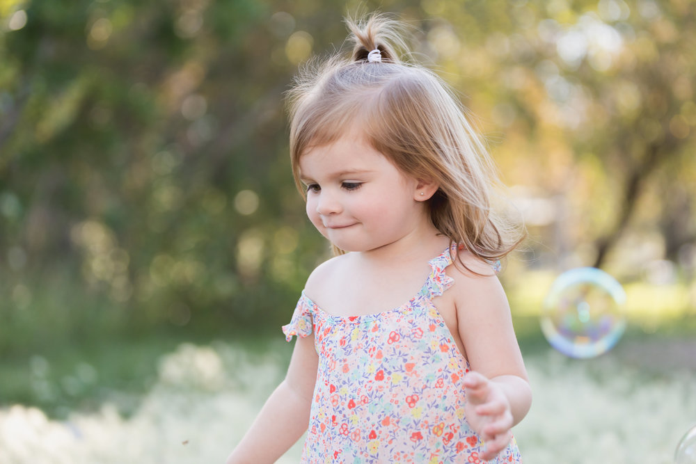 Birthday girl plays with bubbles portrait session.jpg