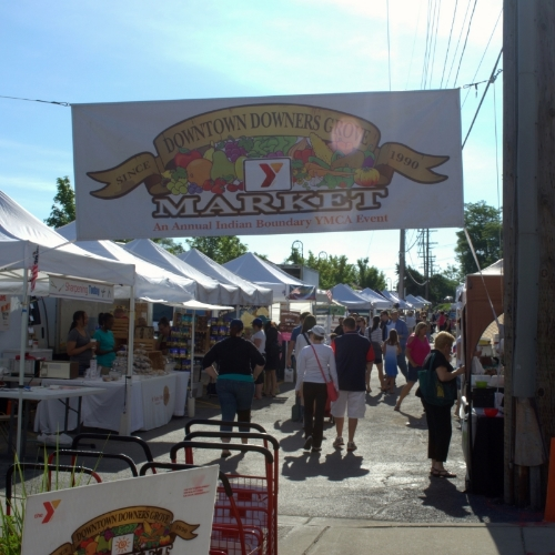 Suburban residents shop at the local Downers Grove farmers market at 7 a.m. on Saturday.